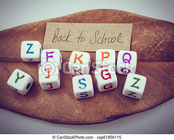Back to school theme with letter cubes - csp61956115