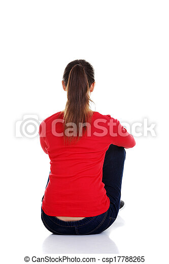 Back view of beautiful young woman sitting on the floor - csp17788265