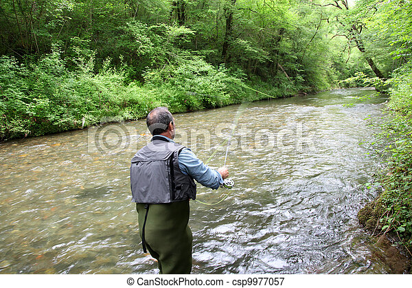 Back view of fisherman in river fly fishing - csp9977057