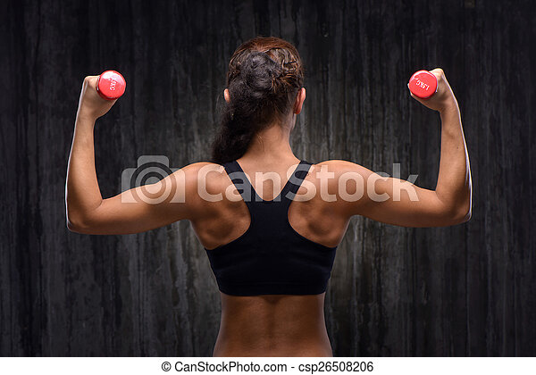 Back view of mixed race sporty woman with dumbbells - csp26508206