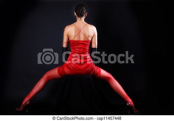 back woman in red outfit - csp11457448