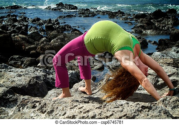 backbend pregnant woman in a yoga backbend pose on a