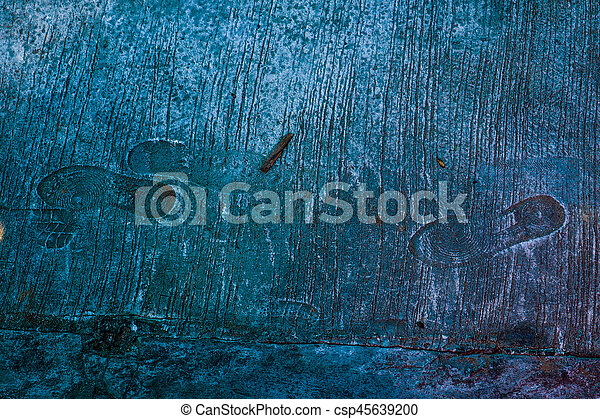 Background cement floor has shoes pattern stamp - csp45639200