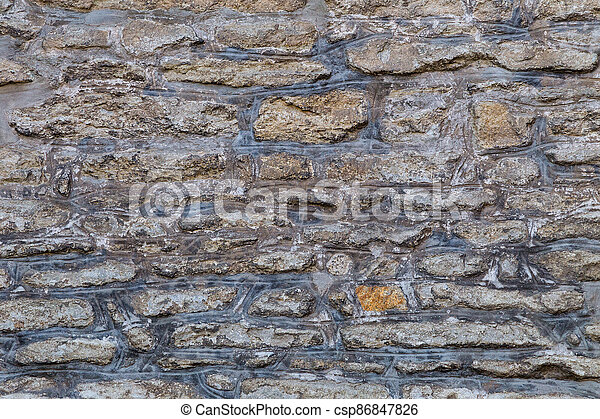 Background from a historic stone wall. - csp86847826