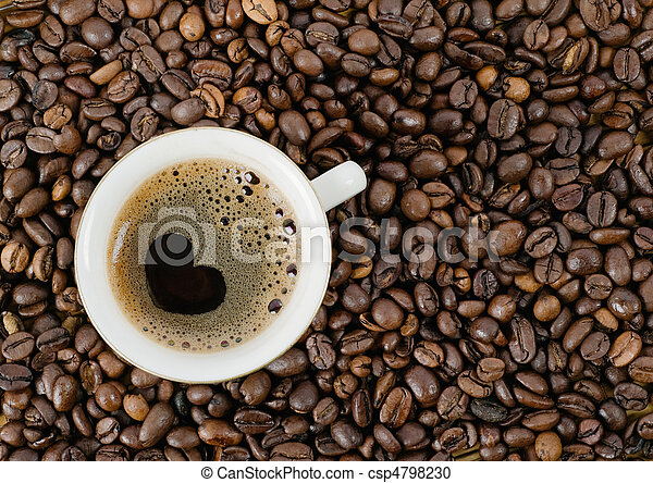Background from coffee grains and a cup from coffee, the top view - csp4798230