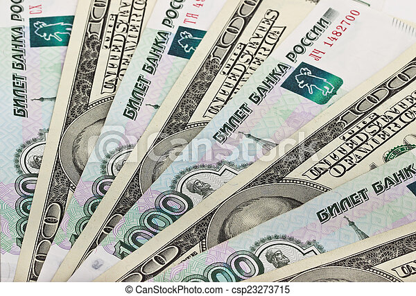 Background from dollars and Russian rubles - csp23273715