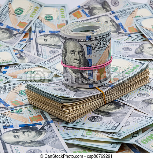 Background from dollars. Notes of one hundred American dollars are scattered across the background. - csp86769291