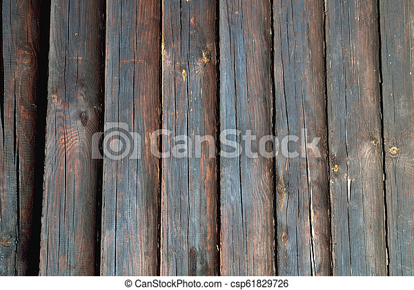 background from wooden natural logs of round brown color - csp61829726