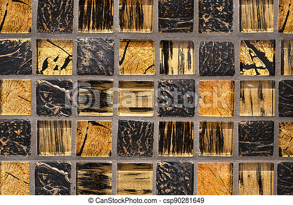 Background made of colored ceramic tiles with a golden mosaic. - csp90281649
