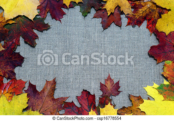 Background of autumn leaves on fabric - csp16778554