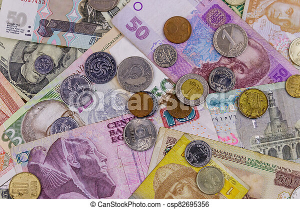 Background of banknotes and coins from different countries - csp82695356