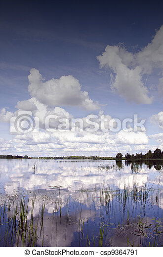 Background of cloudy sky reflection on lake - csp9364791