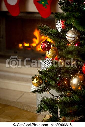 Burning Christmas Tree.Background Of Decorated Christmas Tree In Front Of Burning Fireplace At House