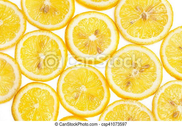 Background of fresh yellow lemon slices on white - csp41073597