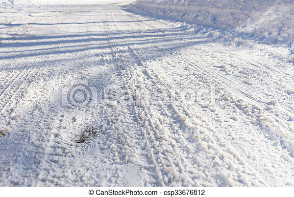 Background of tire tracks in snow - csp33676812