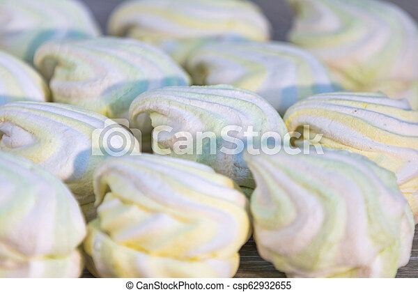 Background or texture of colorful marshmallows on light table background - csp62932655
