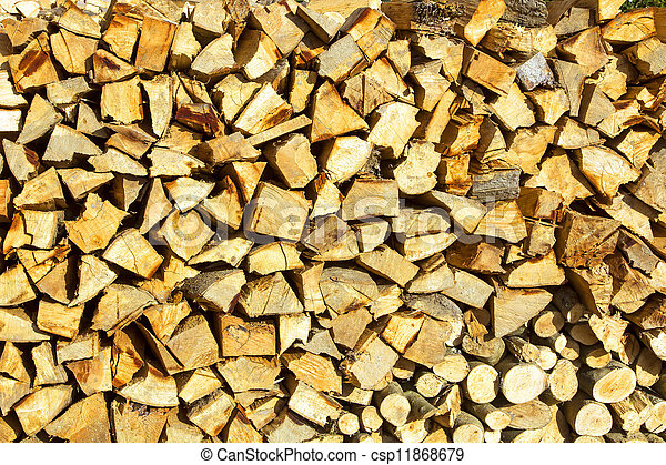 Background or texture symmetric with pieces of wood for stove fireplace - csp11868679
