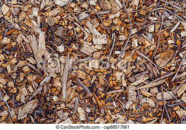 Background texture of natural, tree wood chip mulch ground cover looking head down, brid's eye view. - csp68517661