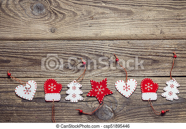 Background with a border of Christmas decorations on an old wooden table. Space for text. - csp51895446