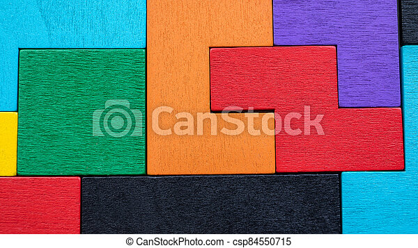 Background with different colorful shapes wooden blocks. Puzzle, mind game and toy - csp84550715