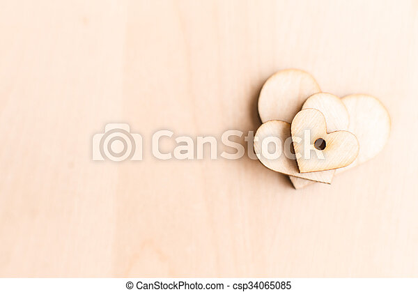 background with wooden hearts - csp34065085