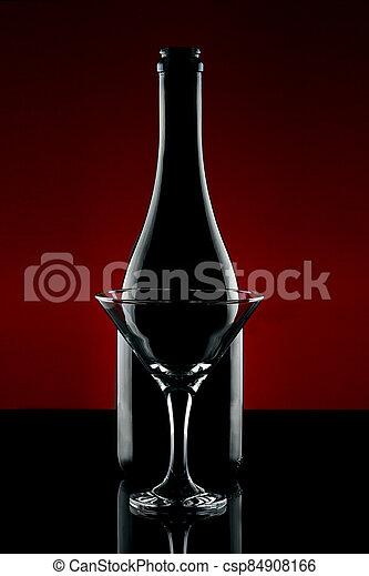 Backlit bottle and cocktail glasses - csp84908166