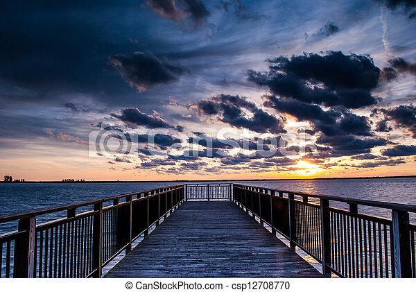 Backlit buffalo pier at sunset - csp12708770