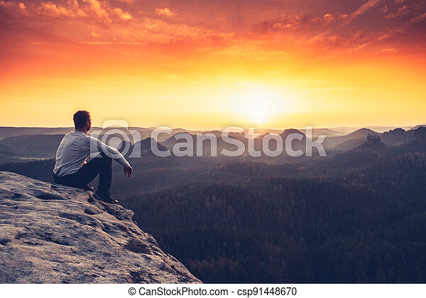 Backpacker in a hike in the summer mountains - csp91448670