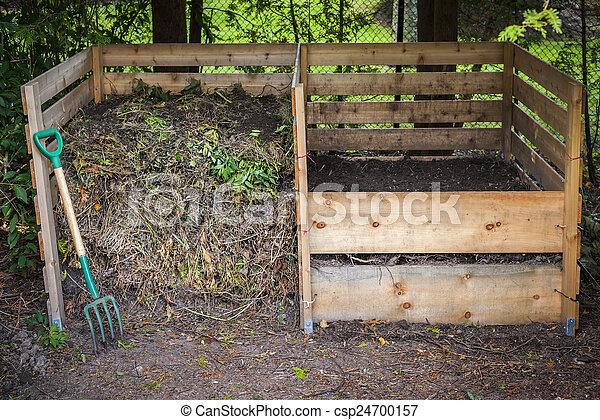 Backyard compost bins - csp24700157