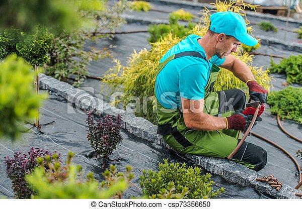 Backyard Garden Irrigation - csp73356650