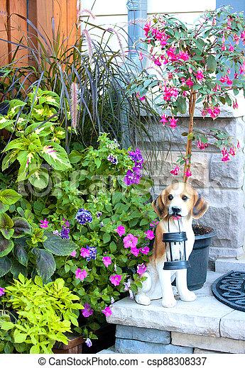 Backyard garden with dog statue - csp88308337