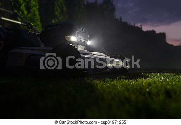 Backyard Grass Mowing During Late Summer Evening Hours - csp81971255