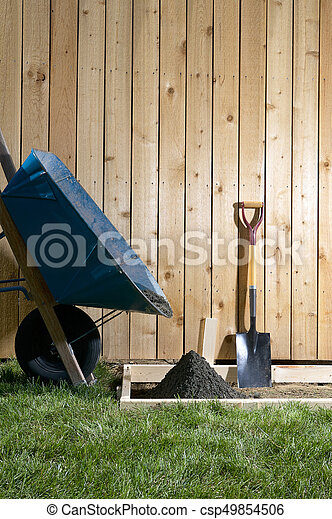 Backyard, home concreting project with wheelbarrow - csp49854506