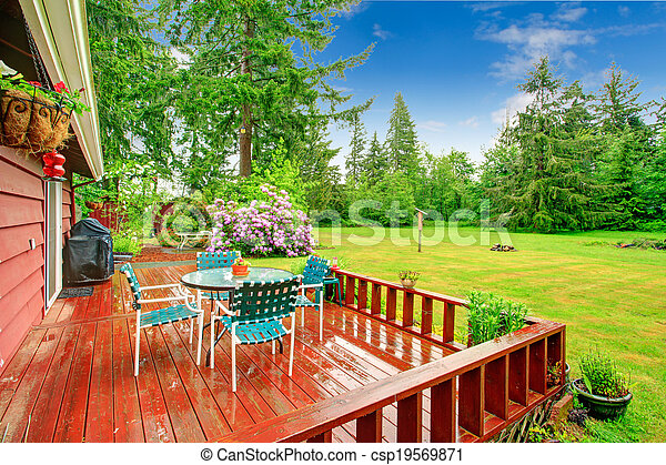 Backyard with patio area - csp19569871
