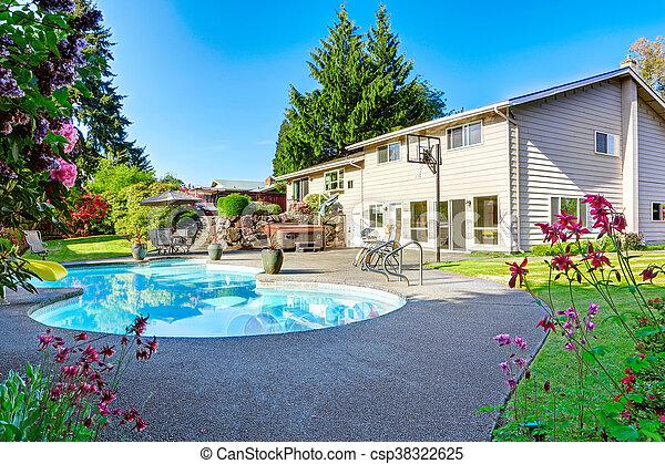 Backyard with small beautiful swimming pool - csp38322625