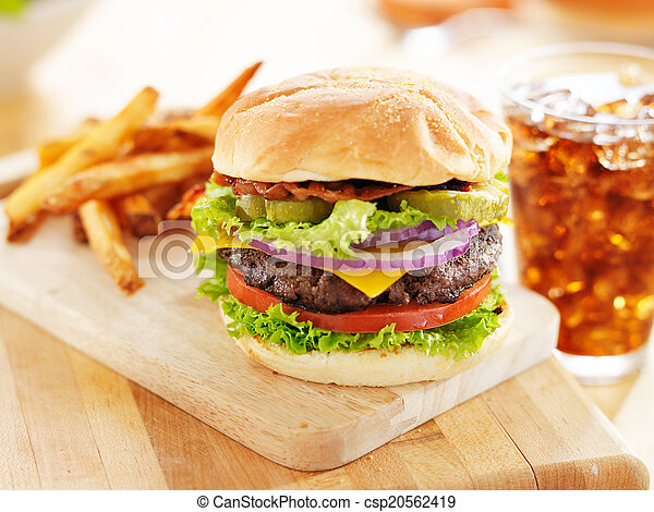 bacon cheeseburger with french fries and soft drink - csp20562419