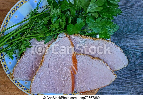 bacon meat with green parsley in a plate - csp72567889