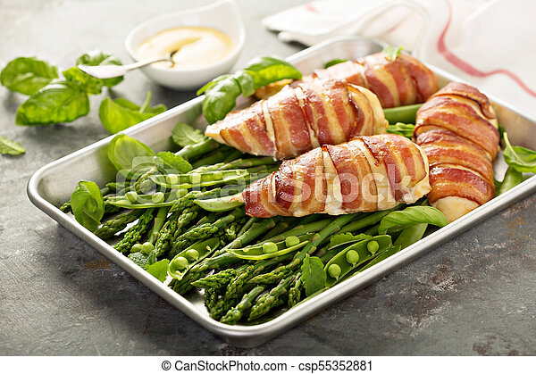 Bacon wrapped chicken breast with asparagus - csp55352881