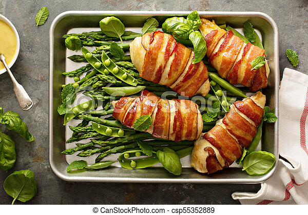 Bacon wrapped chicken breast with asparagus - csp55352889