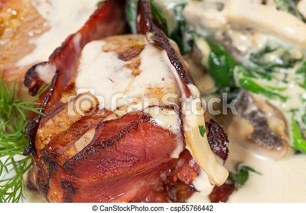 Bacon wrapped pork tenderloin. - csp55766442