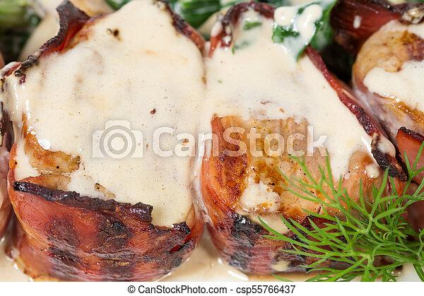 Bacon wrapped pork tenderloin. - csp55766437