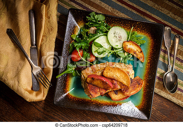 Bacon Wrapped Pork with Apples - csp64209718