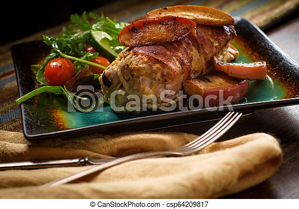 Bacon Wrapped Pork with Apples - csp64209817