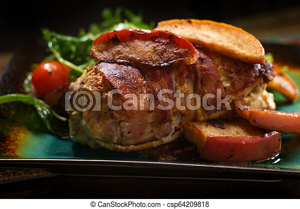 Bacon Wrapped Pork with Apples - csp64209818