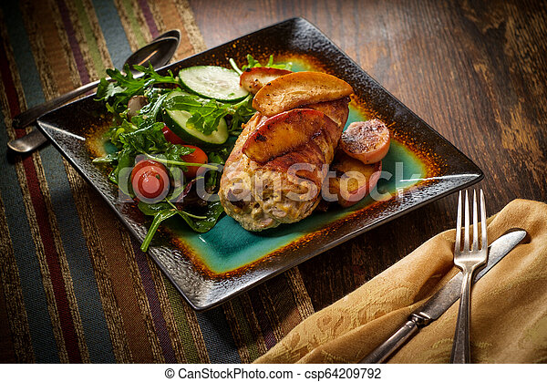 Bacon Wrapped Pork with Apples - csp64209792