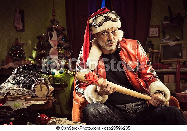 Bad santa with bad christmas gift. Frowning bad santa with baseball ...