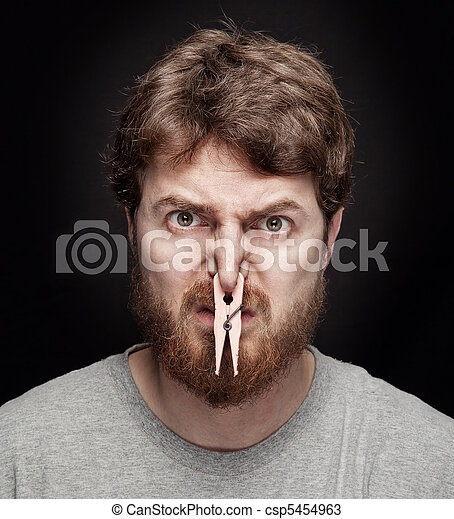 Bad smell concept - peg on male nose - csp5454963