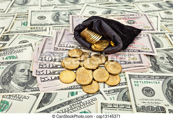 Bag filled with coins over US banknotes background - csp13145371