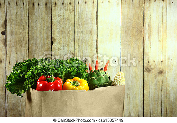 Bag of Grocery Produce Items on a Wooden Plank - csp15057449