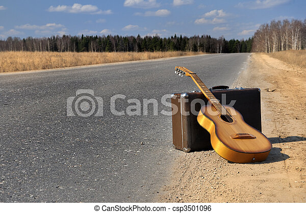baggage and guitar on empty road - csp3501096